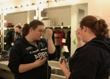 """CWC student Katie Wagner applies her makeup to get ready for her role as the """"Landlady"""" in the performance of 1984."""