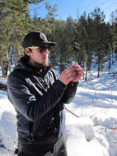 Biol 1080 student Wells Jones examines marrow of mule deer bone