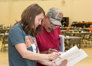 Louisa Hunker helps Robert Gonzales find his movie themed table during in service.