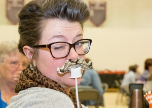 Amara Fehring showing off her mustache at in service.