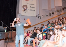 New admissions director Patrick Edwards tosses tshirts to the new students.