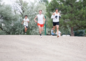 Clay Johnson keeps pace with Gillette runner.