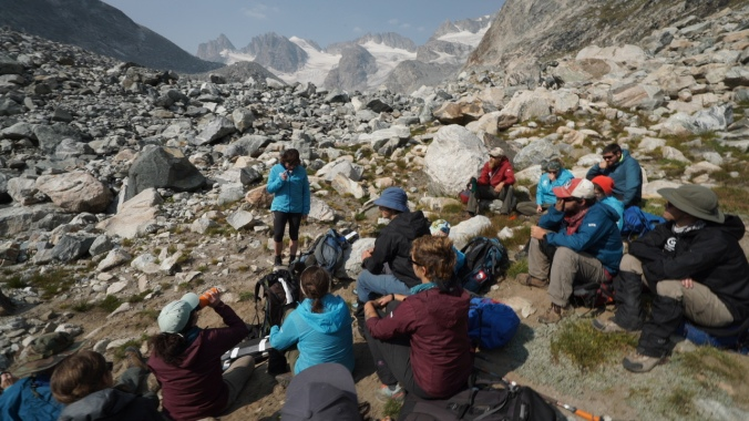CWC Students Attend Class on Ice-Mass Balance at the Terminal Moraine of the Dinwoody Glacier. (Visiting Scholar Sarah Konrad from the University of Wyoming delivers the briefing.) Photo by Kyle Nicholoff