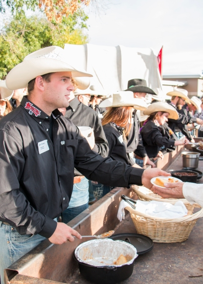 Rodeo team members serving the chuck wagon dinner.