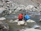 Austin Chase and Lulu Kennedy collect water quality data from the headwaters of Dinwoody Creek.